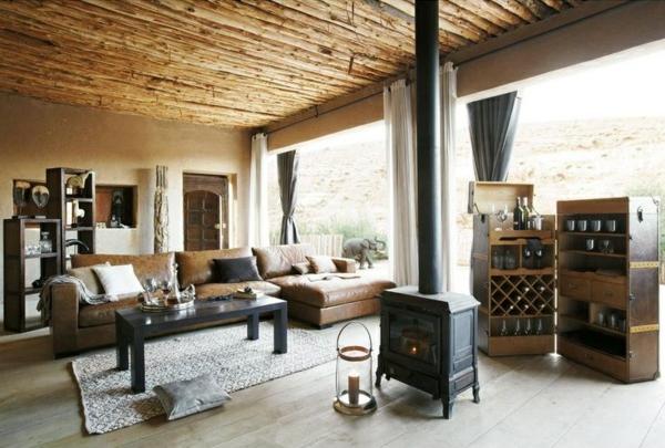 Canapé-d-angle-en-cuir-salon-cheminee-bois-tapis-table-coussins