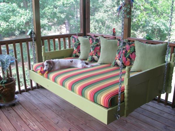 inspiration-bedroom-nice-soft-green-painting-swinging-bed-panels-also-colorful-stripped-mattress-and-chic-green-cushions-over-wooden-floors-and-wooden-fences-as-decorate-outdoor-furnishing-ideas-indo2-resized