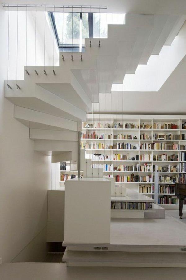 loft-parisien-bibliothèque-et-escalier-demi-tournant