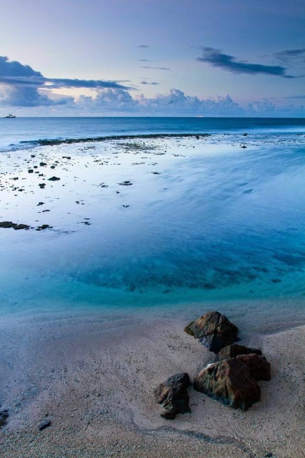 plage-belle-bleu-voyage