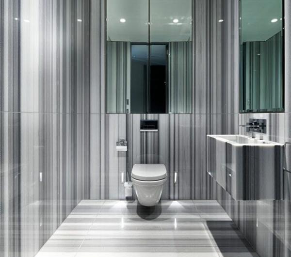 salle-de-bains-grise-intérieur-unique-et-superficies-polies