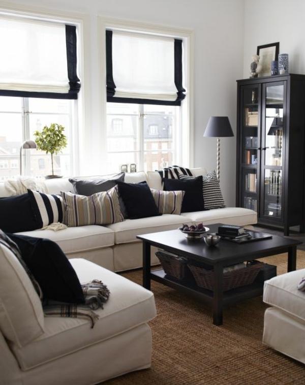 tapis-sisal-sofas-en-couleur-crème-et-buffet-noir