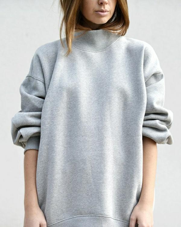1-élégant-pull-gris-femme-mode-cheveux-brunes-tendance