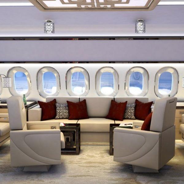 1-avion-privé-salon-canapé-en-cuir-coussins-rouges