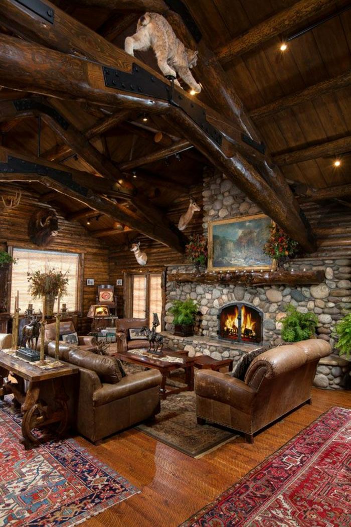1-salon-de-luxe-salon-en-cuir-marron-foncé-tapis-coloré-cheminée-pierre-bois-intérieur