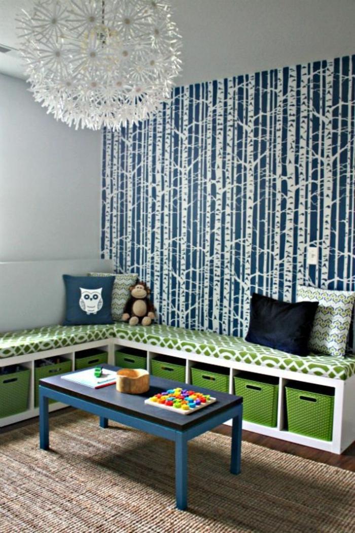 boite-de-rangement-vert-canapé-vert-salle-de-séjour-coussins-colorés