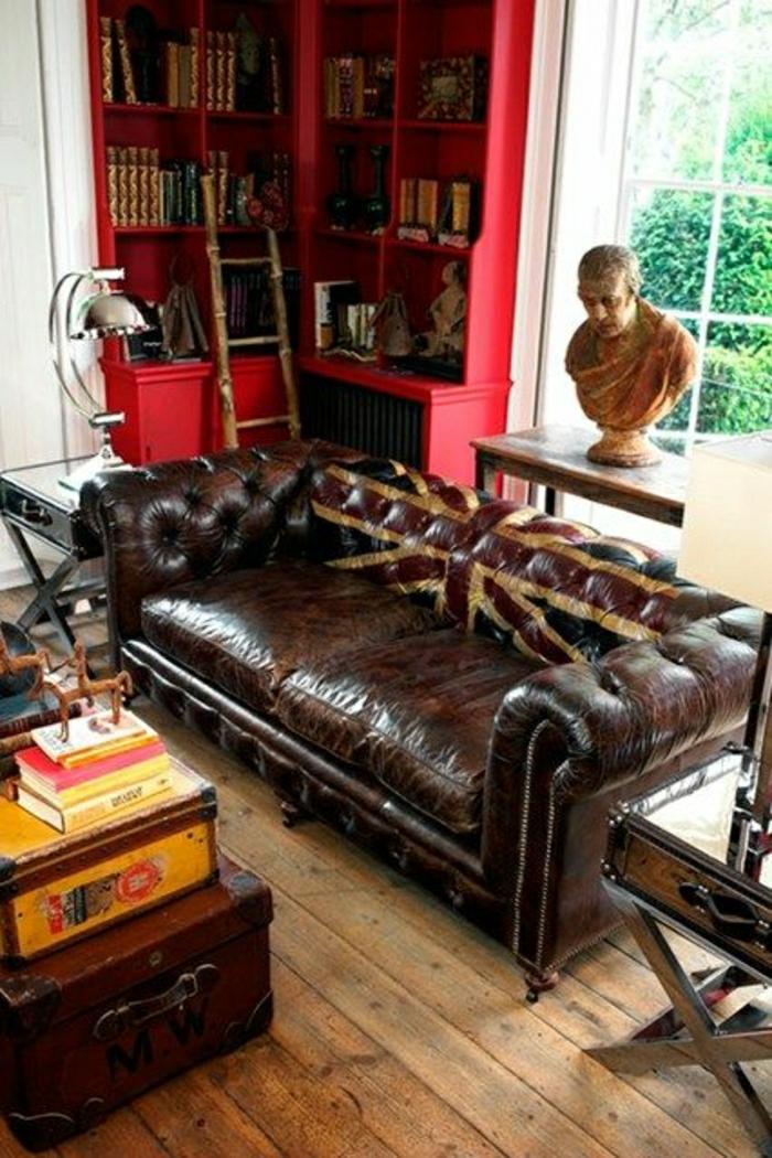 canapé-en-cuir-de-couleur-fenetre-sclupture-sol-plancher-table-valise-meubles