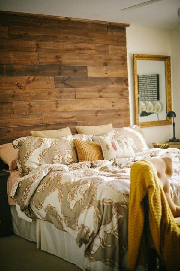 chambre-a-coucher-cocooning-lit-couverture-de-lit-linge-de-lit-beige-tete-de-lit-en-bois-deco-cocooing