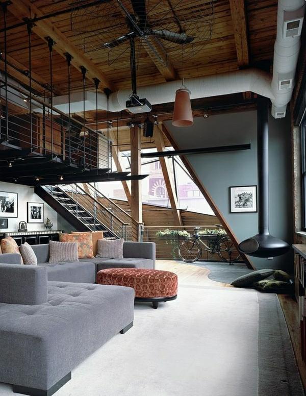 chambre-vaste-canapé-gris-salon-confortable-coussins-colorés-escalier-industriel