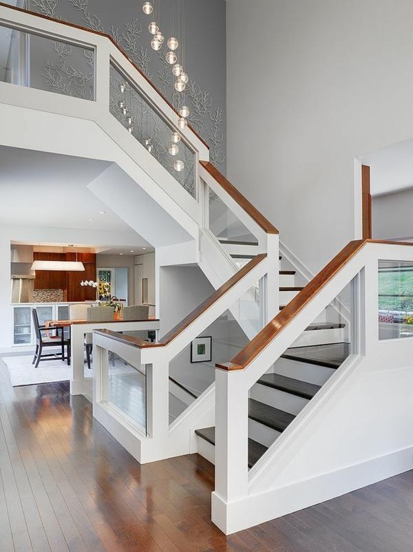 Designs d 39 escaliers avec garde corps en verre for Rambarde escalier interieur