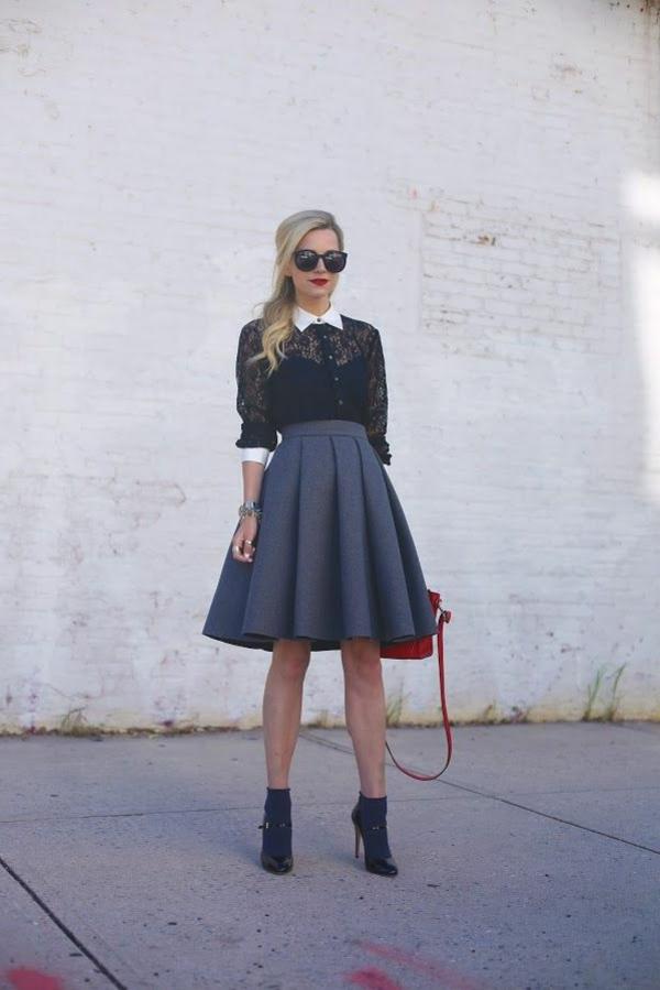 jupe-trapeze-gris-look-élégant-femme-blonde-lunettes-de-soleil-noir