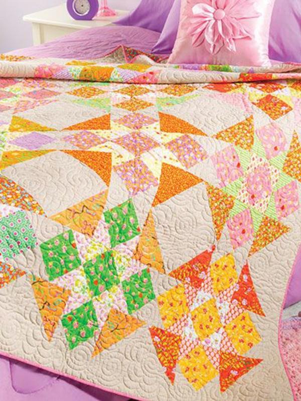 lits-couvre-jeté-lit-coussins-pièce-à-coucher-motif-geometrique