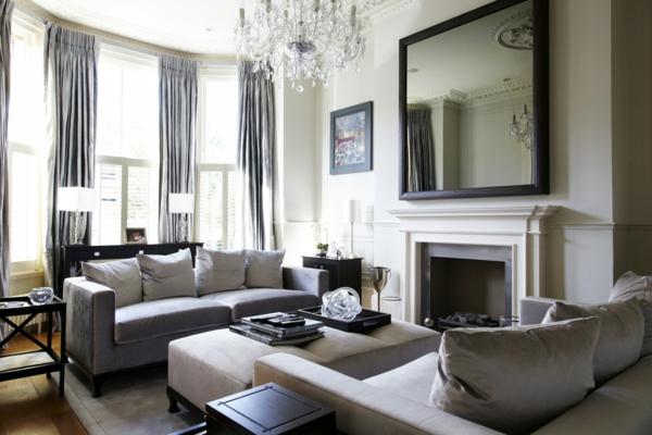 lustre-en-cristal-cheminée-blanche-et-sofas-gris