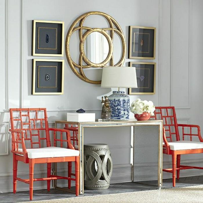meuble-table-élégant-miroir-décoratif-lampe-blanche-décorative-chaise-rouge
