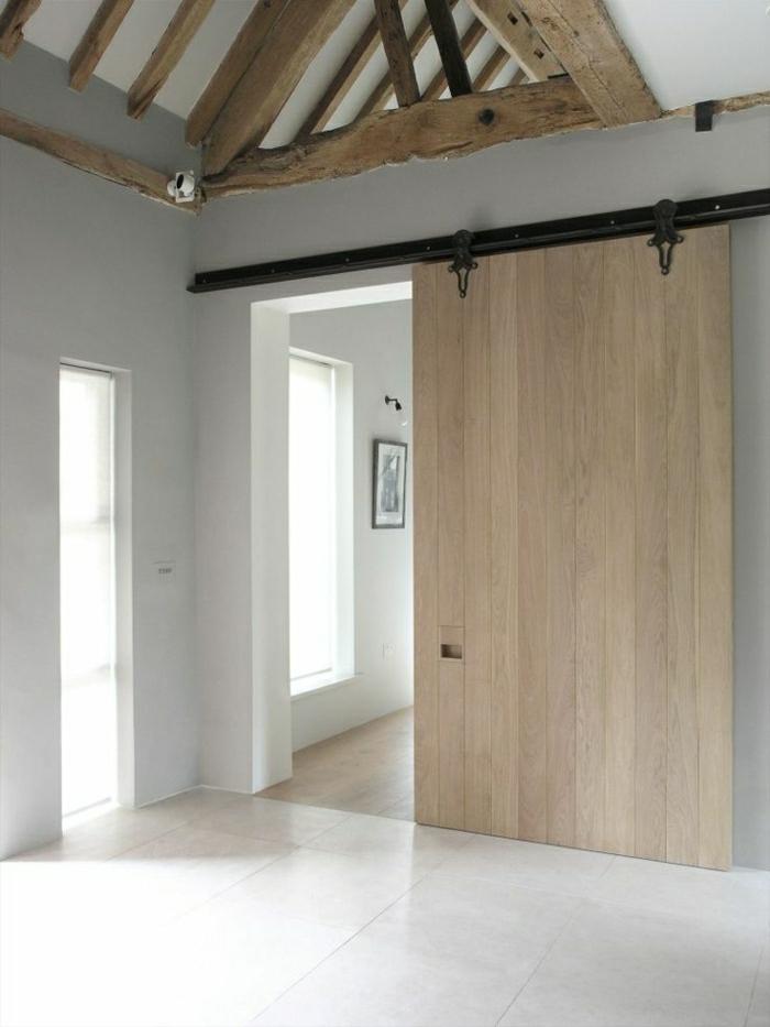 porte-coulissante-intérieur-moderne-porte-en-bois-carrelage-murs-blancs-peintures