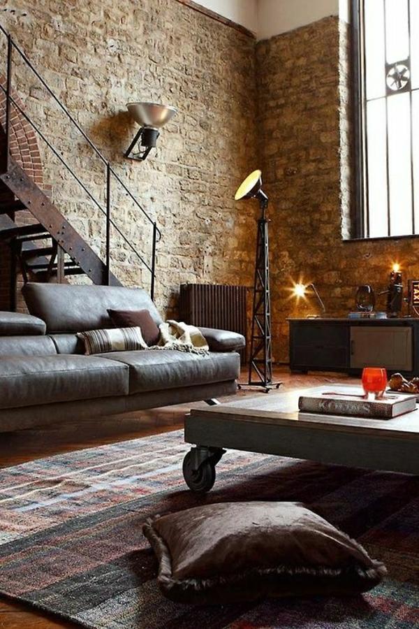 salon-aménagement-industriel-canapé-en-cuir-table-basse-murs-en-pierres