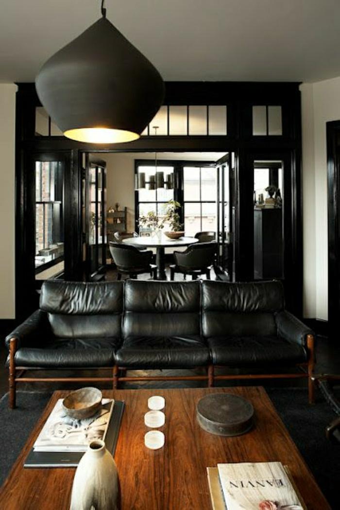 salon-cuir0noir-canapé-table-en-bois-lustre-noir-salon-tapis-noir-table