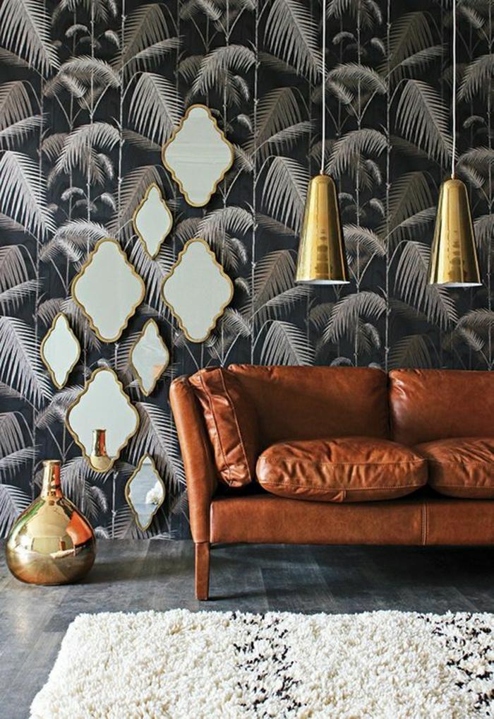 salon-en-cuir-canapé-en-cuir-lustre-suspendue-mur-noir-tapis-blanc