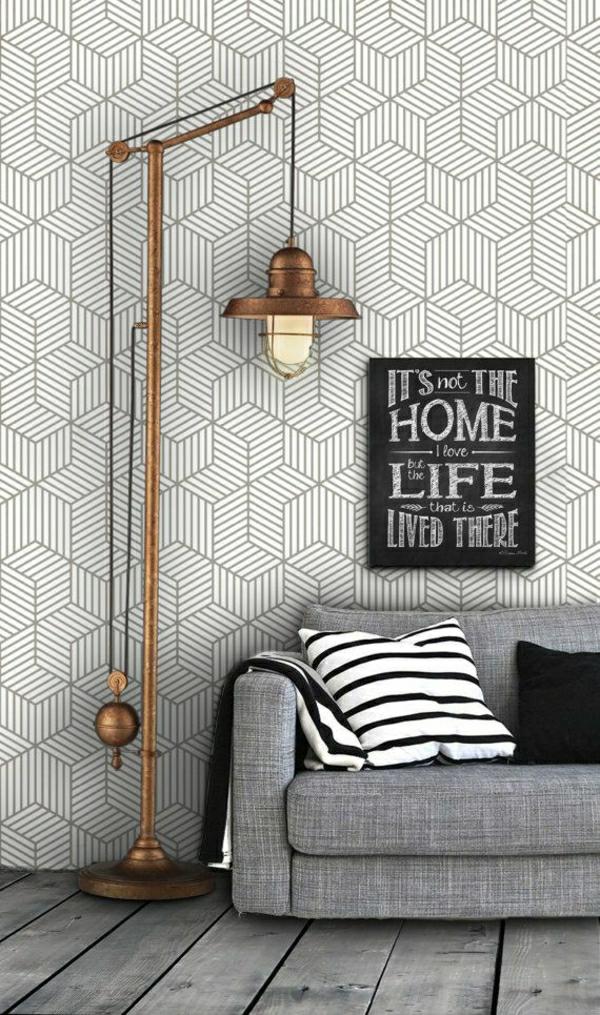 salon-moderne-lampe-de-chevet-en-fer-fauteuil-gris-coussins-blanc-noir