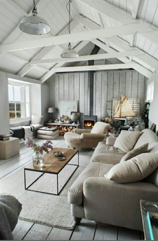 salon-vaste-avec-cheminée-table-basse-en-bois-fer-forgé-canapé-beige-gris-sol-plancher