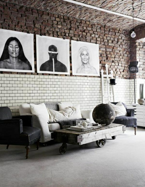 table-basse-sol-gris-peintures-murales-mur-en-briques-canapé-en-cuir