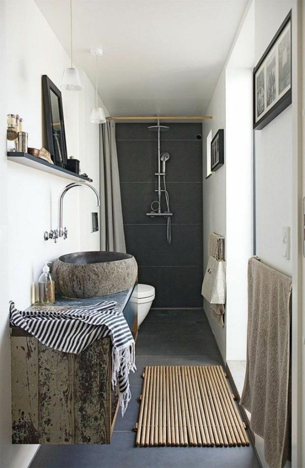 vasque-en-pierre-et-carrelage-noir-dans-la-salle-de-bains