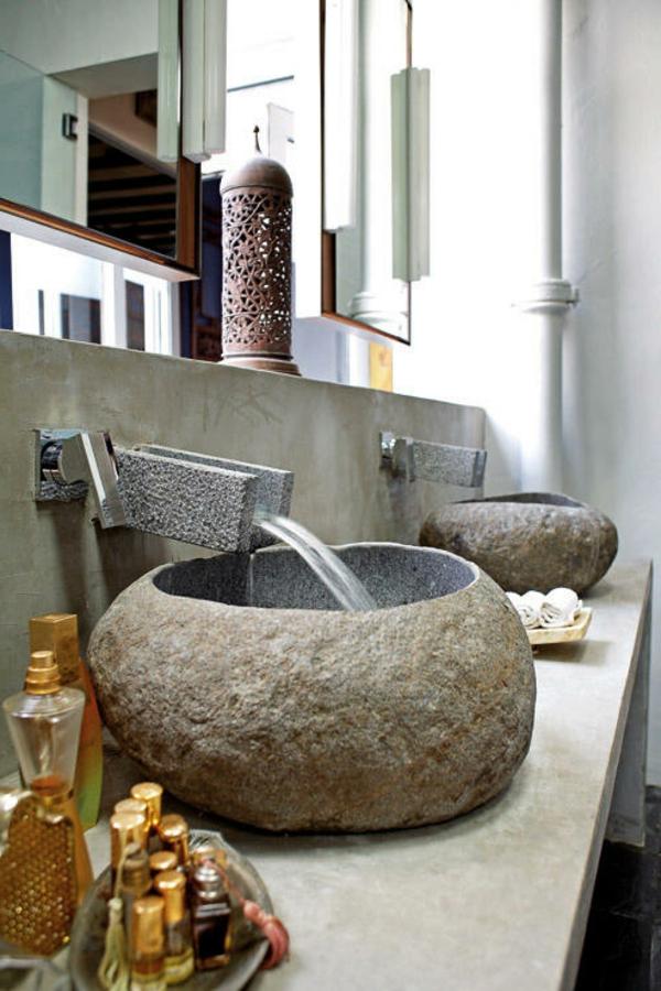 vasque-en-pierre-lavabos-originaux-en-pierresur-un-plateau-en-béton