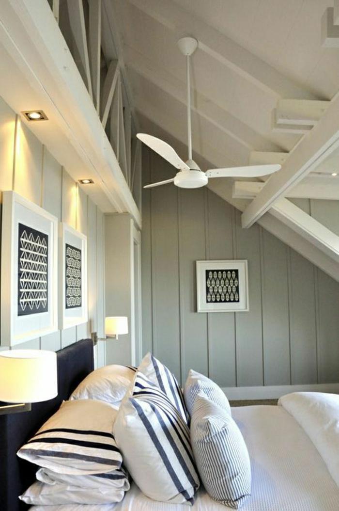 ventilateur-design-plafond-lustre-insolite-murs-en-bois-gris-coussins-linge-de-lit-élégant