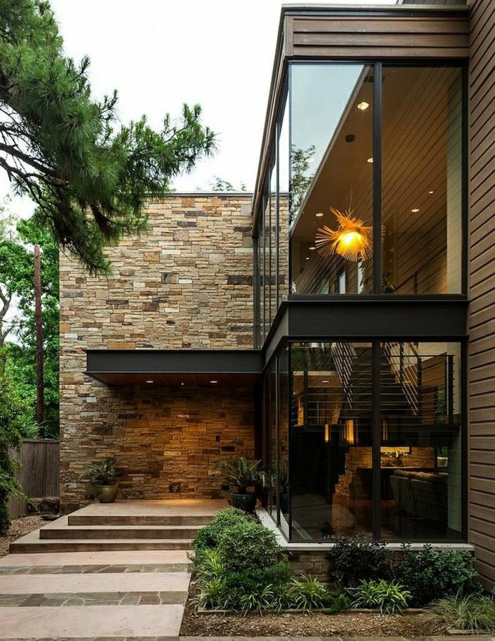 1-batiments-atypiques-architecture-maison-extérieur-de-pierre-plantes-vertes-jardin
