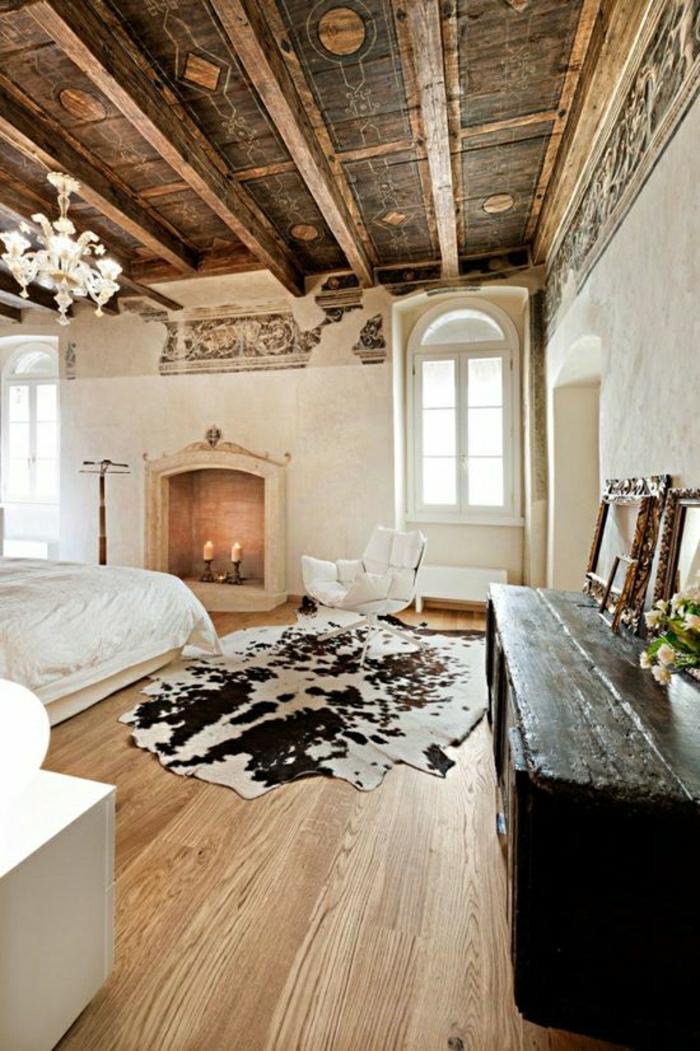 1-chambre-a-coucher-intérieur-rustique-meuble-en-bois-tapis-peau-de-vache-blanc-noir
