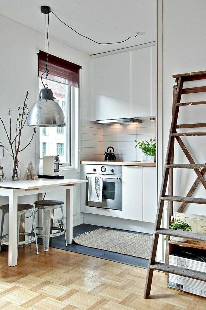 La table haute de cuisine est ce qu elle est confortable - Table de cuisine pour studio ...