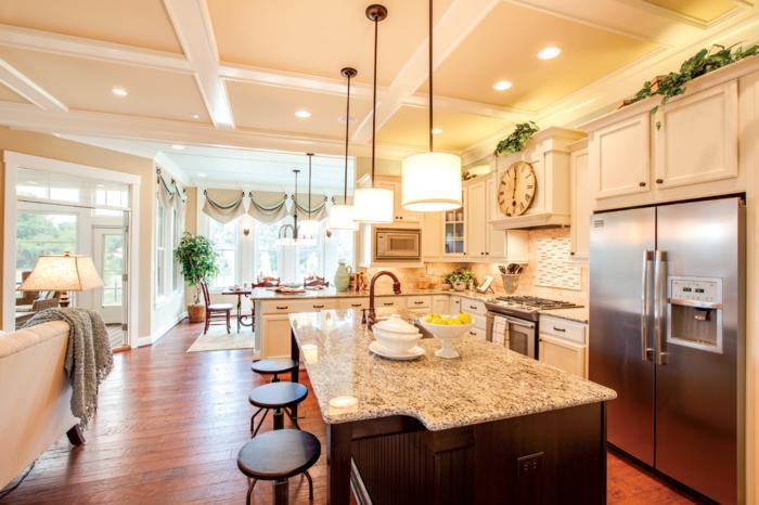 2-Appartement-lux-style-couleurs-caramel-cuisine-comblete-blanc-marbre-chaises-hautes