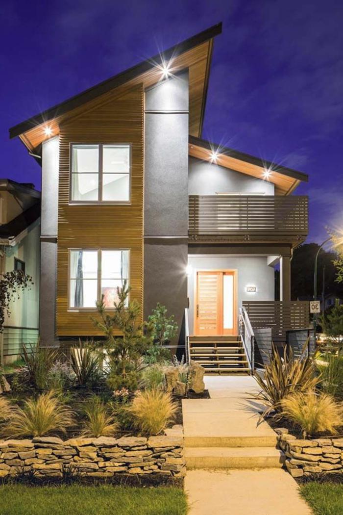 maison-avec-luminaires-extérieurs-jardin-plantes-vertes-maison-extérieur-gris