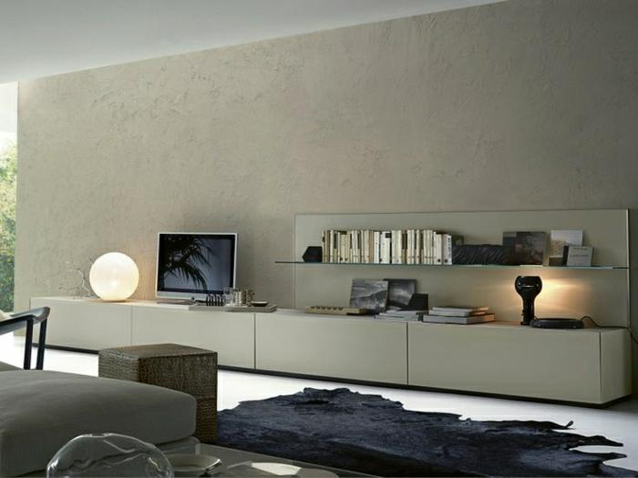 meuble-tv-design-tapis-noir-peau-d-animal-noir-mur-beige-foncé-lampe-de-chevet