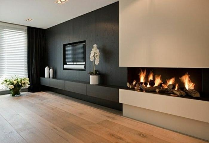 meuble-tv-en-bois-noir-salon-ambiance-cocooning-cheminée-sol-en-parquet-fleurs