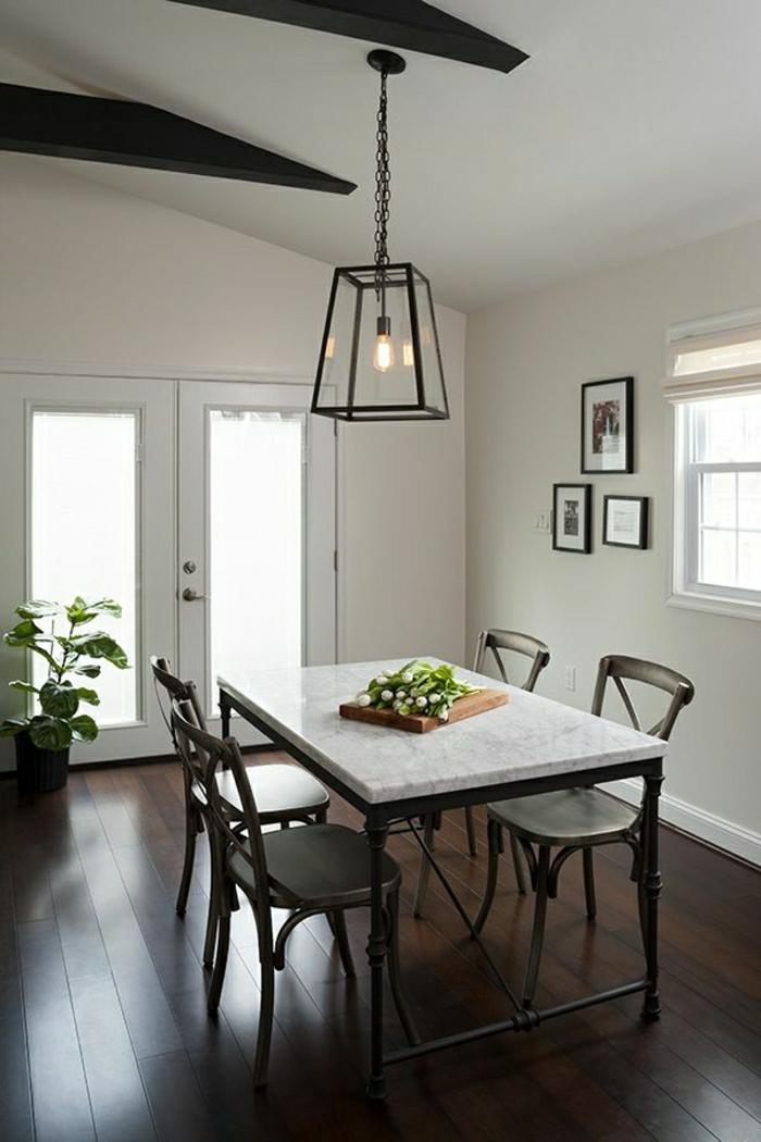 table-en-bois-marbre-blanc-plante-verte-lustre-de-salon-porte-d-entrée-en-bois-blanc