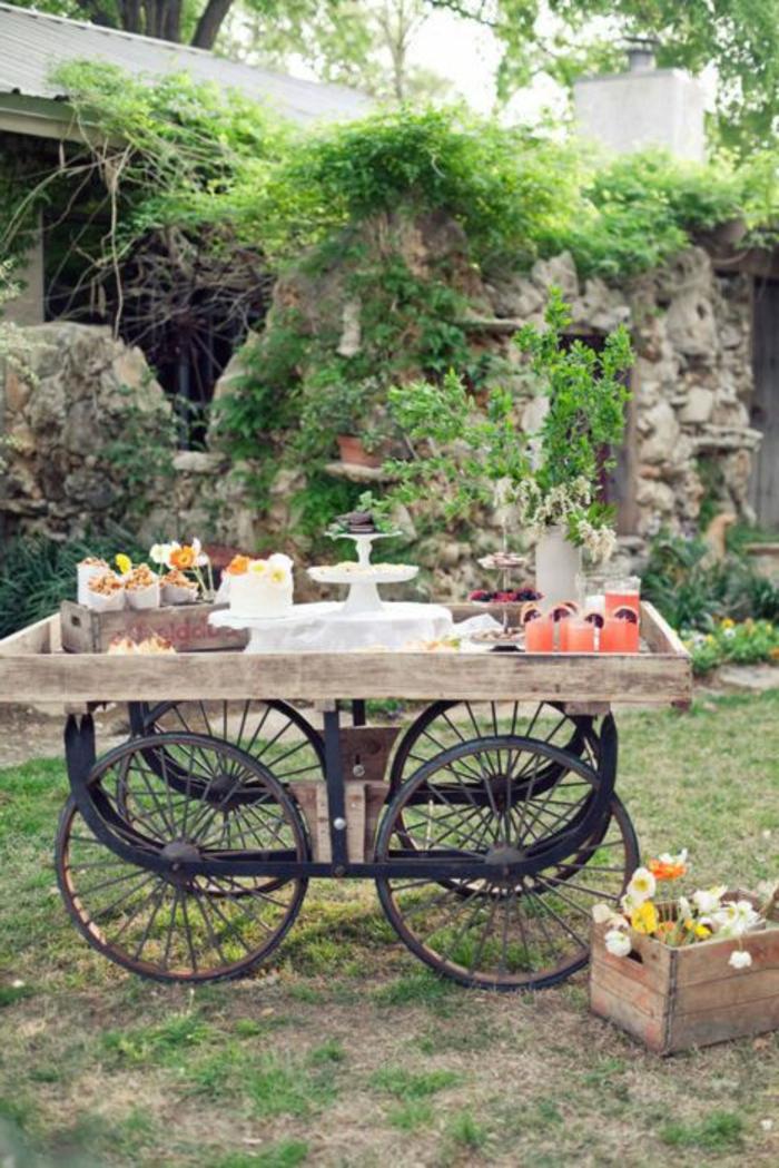 une-belle-table-rustique-sur-la-pelouse-fleurs-meubles-en-bois-plantes-vertes