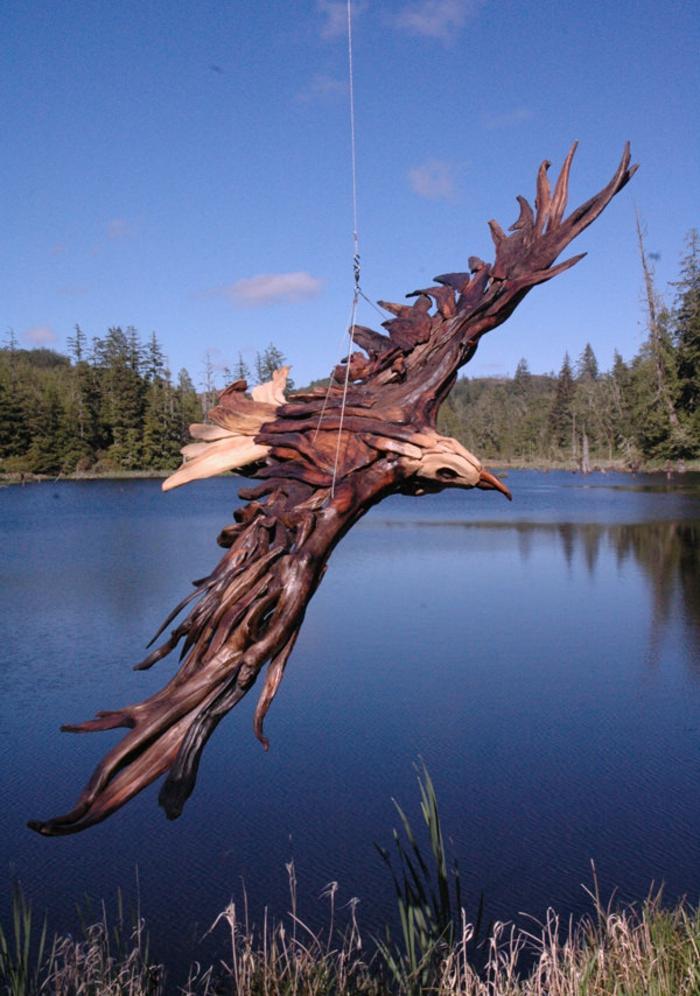 Driftwood-Sculpture-de-Jeff-Uitto-jolie-sculpture-sur-bois-oiseaux-magestique