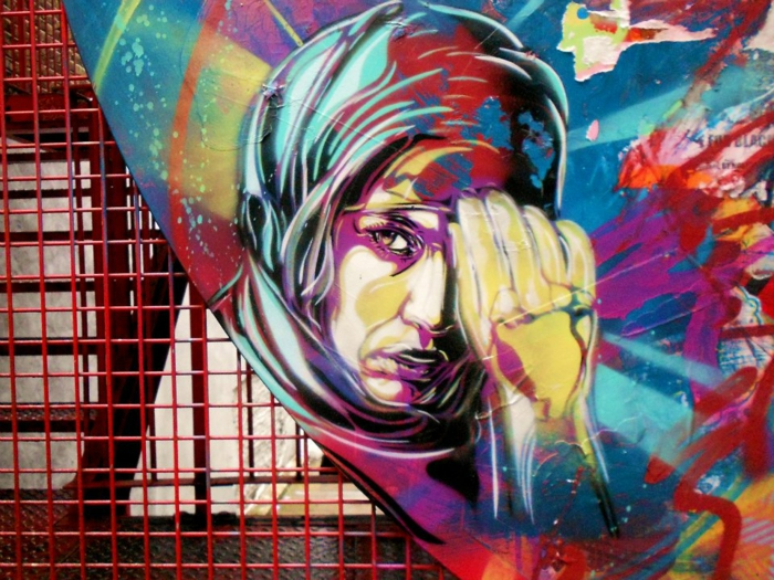 Graffiti-technique-pochoir-street-art-C215-portrait-femme