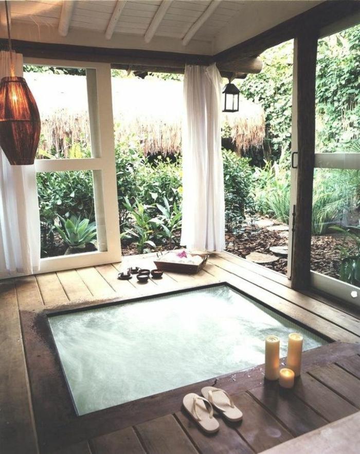 baignoir-jacuzzi-baignoire-angle-balnéo-design-moderne-bougies-plantes-vertes