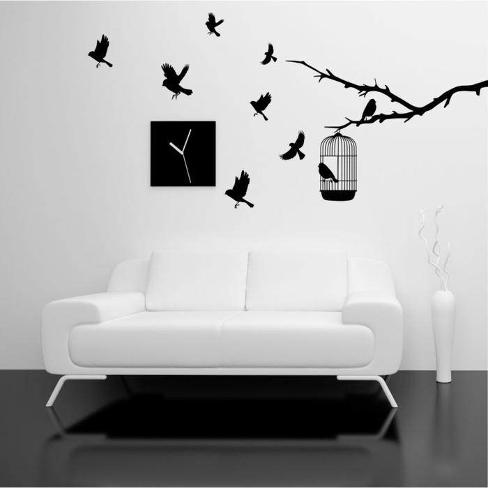 idée-déco-chambre-à-coucher-ou-salon-arbre-et-oiseaux-sofa-blanc