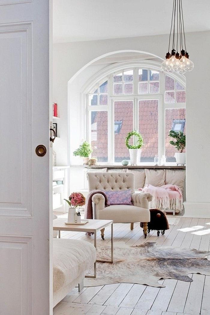 intérieur-de-style-scandinave-salon-moderne-meubles-scandinaves-sol-en-parquet-tapis-peau-d-animal