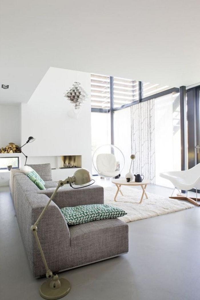 meubles-scandinaves-palaiseau-canapé-gris-tapis-blanc-dans-le-salon-moderne-de-style-scandinave