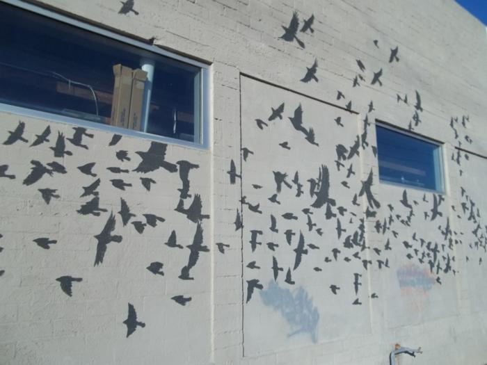 pochoir-street-art-tableau-idée-créative-sur-batiment