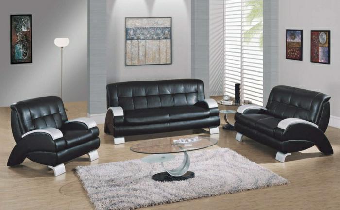 salon-avec-meubles-en-cuir-noir-table-basse-en-verre-plateau-ronde-en-verre