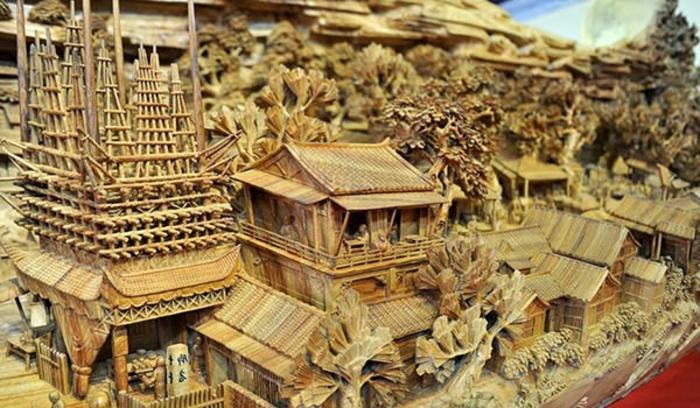 sculpture-sur-bois-de-Zheng-Chunhui-peinture-cité-en-bois