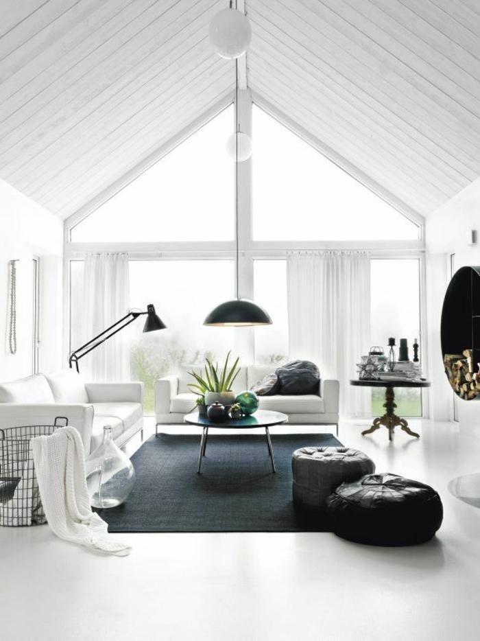 table-basse-scandinave-deux-poufs-et-chambre-blanche