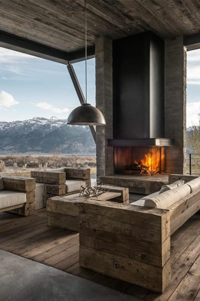 un-joli-salon-avec-ambiance-cocooning-cheminée-dans-le-salon-sol-en-parquet-canapé-en-bois