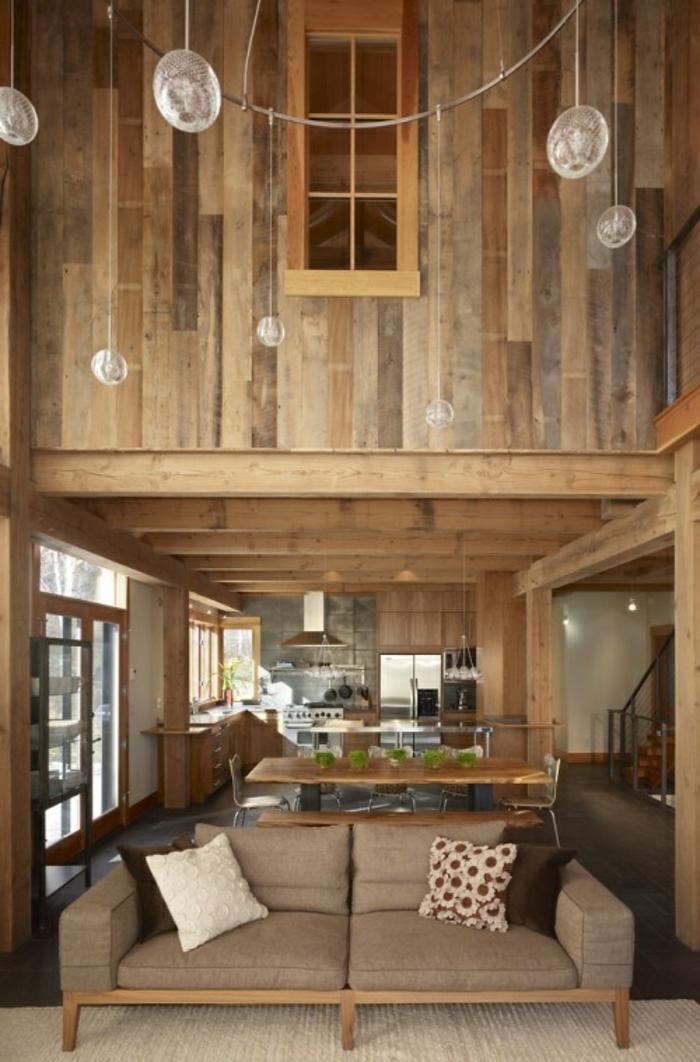 une-jolie-chalet-bois-habitable-maison-dans-la-montagne-canapé-marron-dans-le-salon-rustique
