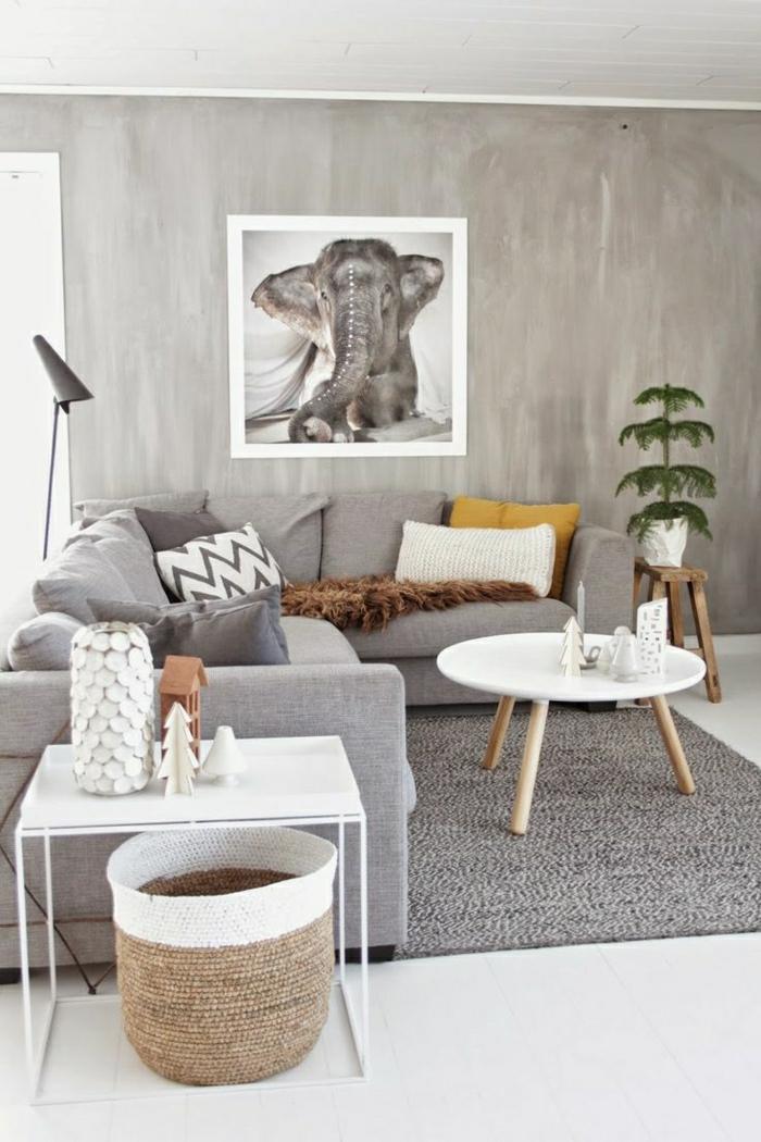 une-jolie-table-basse-en-bois-salon-avec-petite-table-basse-en-bois-tapis-gris-peintures